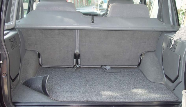 Trunk carpet attachment